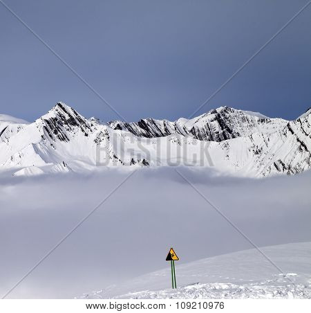 Mountains In Mist And Warning Sing On Off-piste Slope