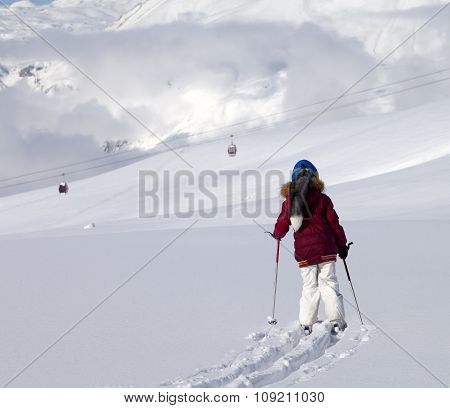 Girl On Skis In Off-piste Slope With New Fallen Snow At Sun Day