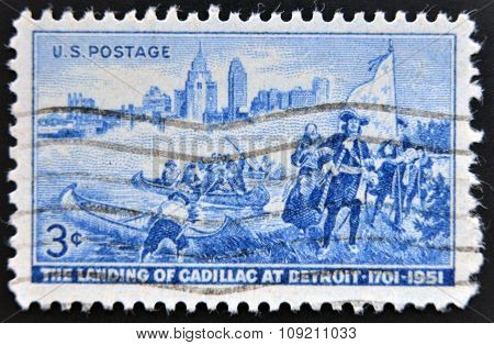 a stamp printed in USA shows Detroit Skyline and Cadillac Landing