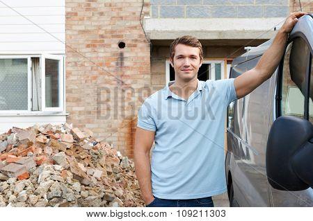 Builder Standing Next To Van