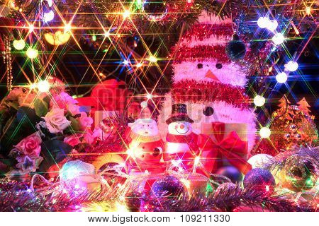 Santa Claus And Snowman With A Decorated Christmas Tree With Light