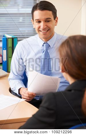 Businessman Interviewing Female Job Applicant