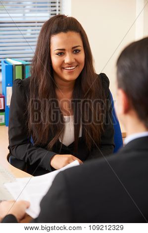 Teenage Girl Being Interviews For Job