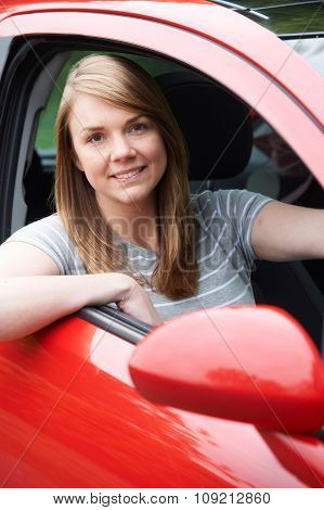 Portrait Of Young Female Driver In Car
