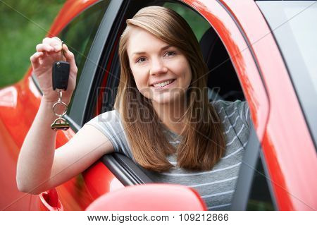 Young Female Driver In Car Holding Keys