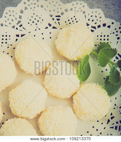 Vintage Photo Of Homemade Coconut Pralines On Plate With Mint