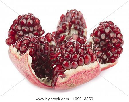 Close-up of a pomegranate isolated on white background.