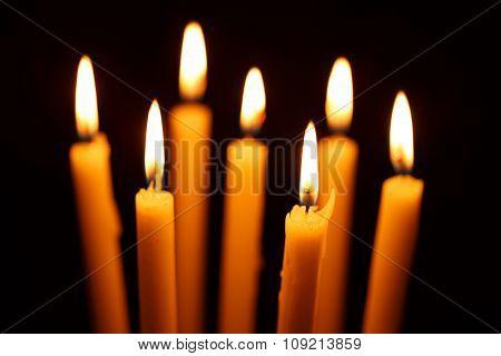 Many Burning Candles On Black