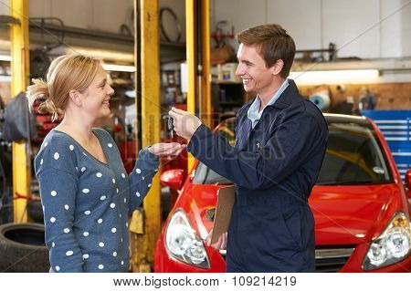 Happy Customer Collecting Car From Garage