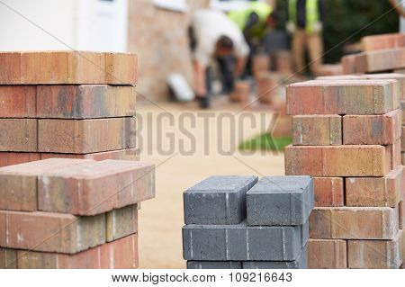 Close Up Of Blocks Waiting To Be Laid On New Patio
