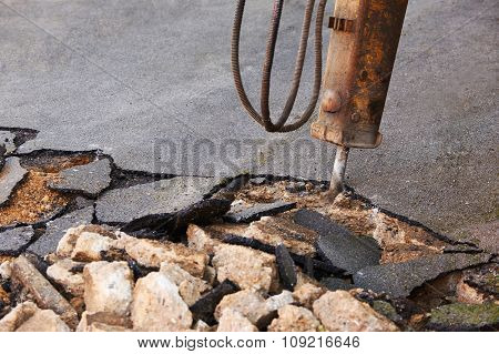 Breaking Up Surface Of Road For Repair With Jackhammer