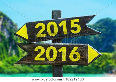 2015 - 2016 signpost in a beach background
