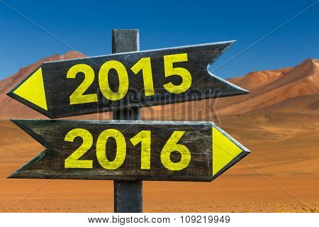 2015 - 2016 signpost in a desert background
