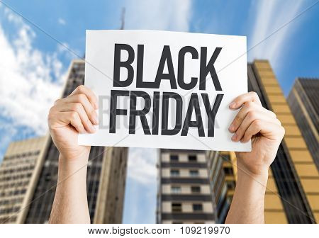 Black Friday placard with urban background