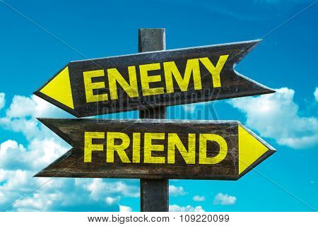 Enemy - Friend signpost with sky background