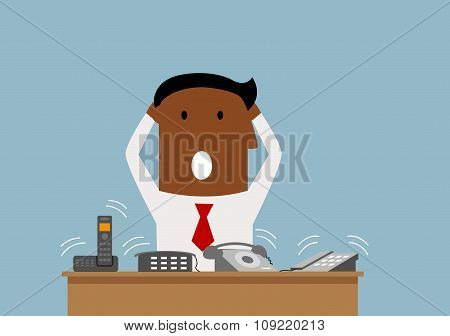 Overworked businessman with many phone calls