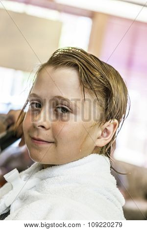 Young Boy At The Hairdresser
