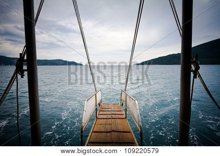 Republic Of Montenegro. Sea, Mountains And Clouds In The Sky. View From The Back Trap Of The Boat.