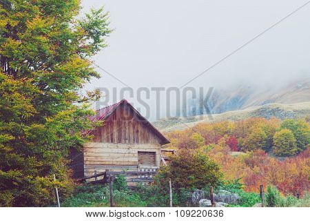 Mountains In Autumn. Abandoned Warehouse In A Highlands. National Nature Park