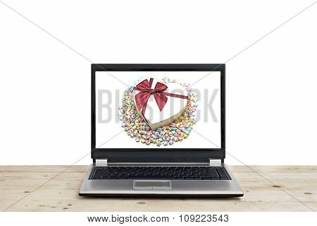 Gift And With Origami Lucky Stars On Laptop Screen