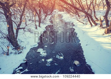 Small river in winter sunny day