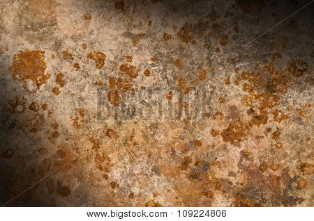 Metal Background With Rusty Corrosion Lit Diagonally
