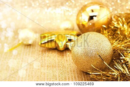 Golden Christmas Decorations On Shiny Background With Copy Space For Text. Holiday Background Or Gre