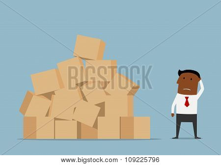 Worried businessman and large pile of boxes