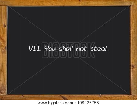 The seventh commandment of christian catholic on a blackboard
