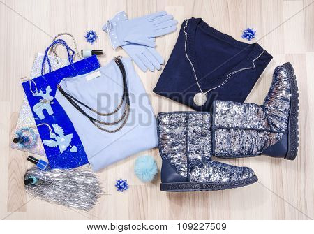 Winter Christmas Sweaters And Sparkly Boots With Accessories Arranged On The Floor.