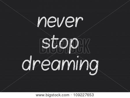 never stop dreaming written on a blackboard