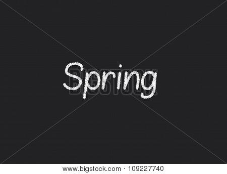 Spring written on a blackboard