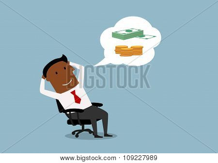 Businessman dreaming about money and wealth