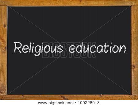 Religious education written on a blackboard