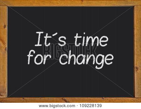 It´s time for change written on a blackboard