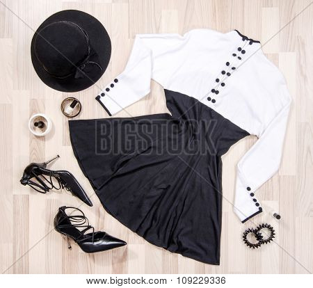 Cute Dress With Buttons And Accessories Arranged On The Floor.