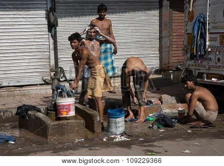Young Indian Guys Washing In The Road