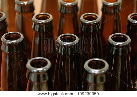 Rows of empty brown beer bottles