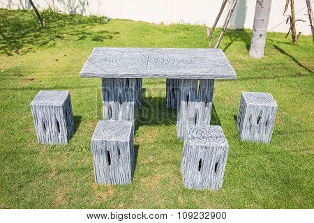 Modern Table And Chairs Set Standing On A Lawn At The Garden