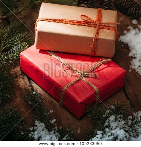 gift boxes and fur tree on wooden background