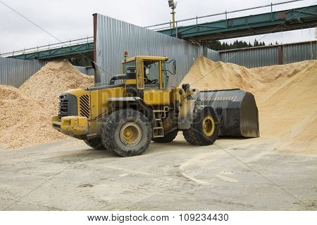 Front End Loader Working In Sawdust Storage Area