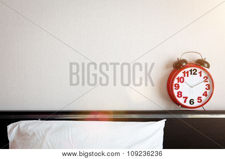 Red Alarm Clock On The Bed With Copyspace