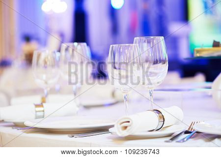 catering services background with glasses for wine on table in restaurant