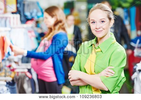 Portrait of sales assistant or seller in baby product shoppping center