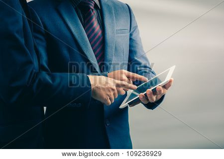 Two Businessmen Using Tablet-pc : Filtered Process