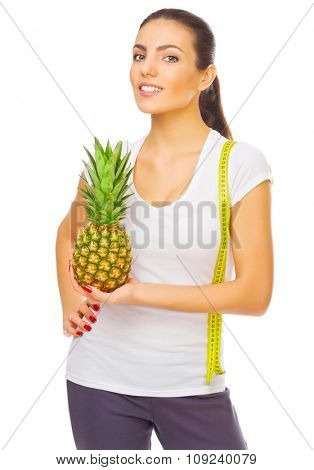 Young smiling girl with pineapple isolated