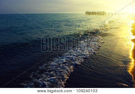 Blue sea and sun on sunset