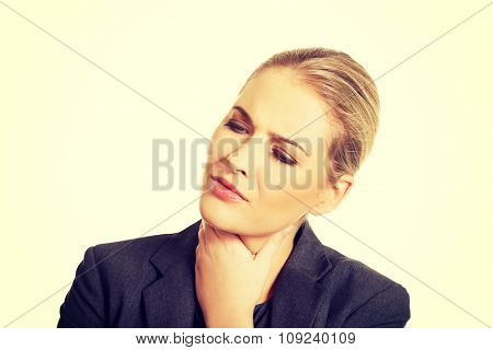 Businesswoman with terrible throat pain.