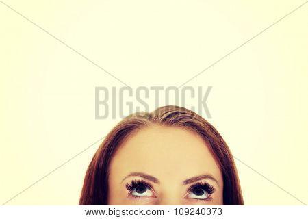 Beautiful female eyes looking up.