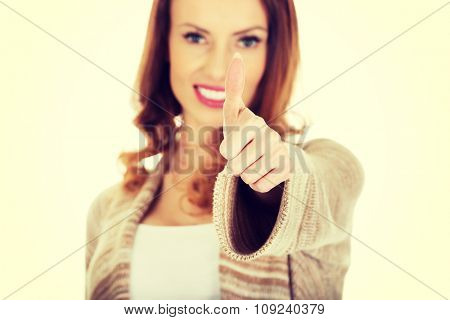 Beautiful smiling woman showing thumbs up.